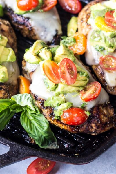 Avocado Caprese Chicken in skillet