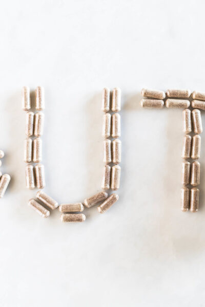 gut spelled out with digestive enzyme pills