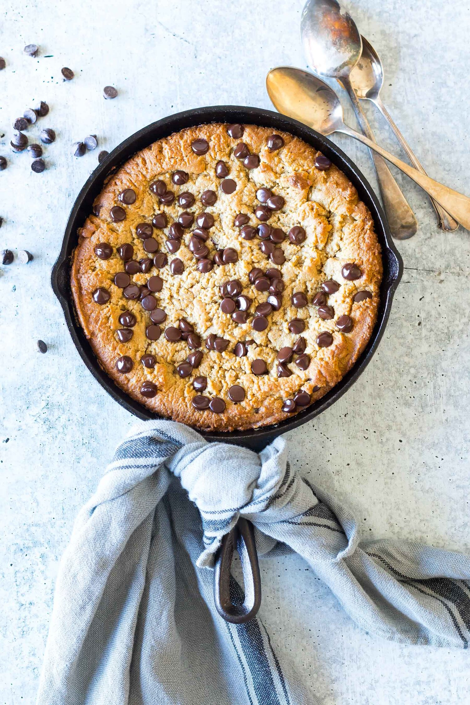 Finished Keto Chocolate Chip Peanut Butter Skillet Cookie in a 8 inch skillet
