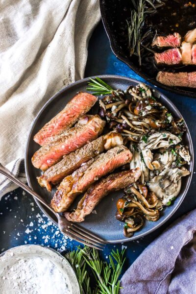 Cast Iron Steak on a plate with Garlic Butter Mushrooms