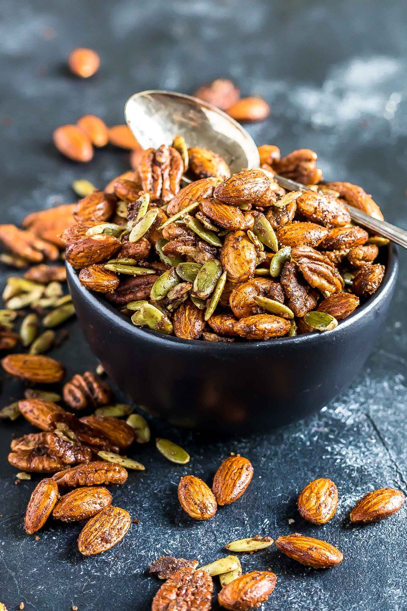 Chai Spiced Mixed Nuts in a small black bowl.