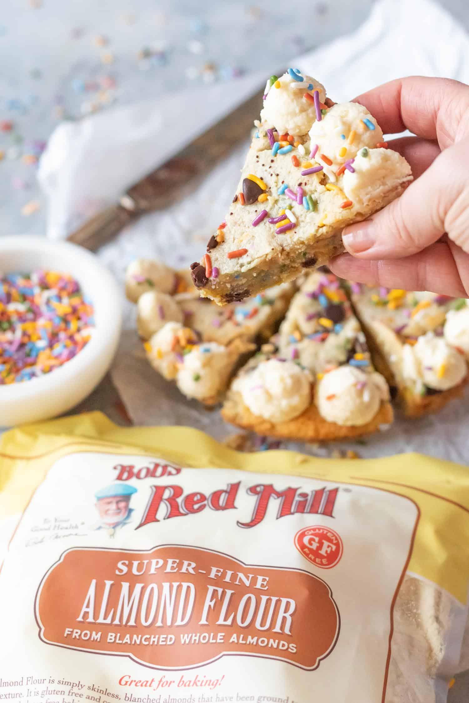 Keto Confetti Skillet Cookie slice being held