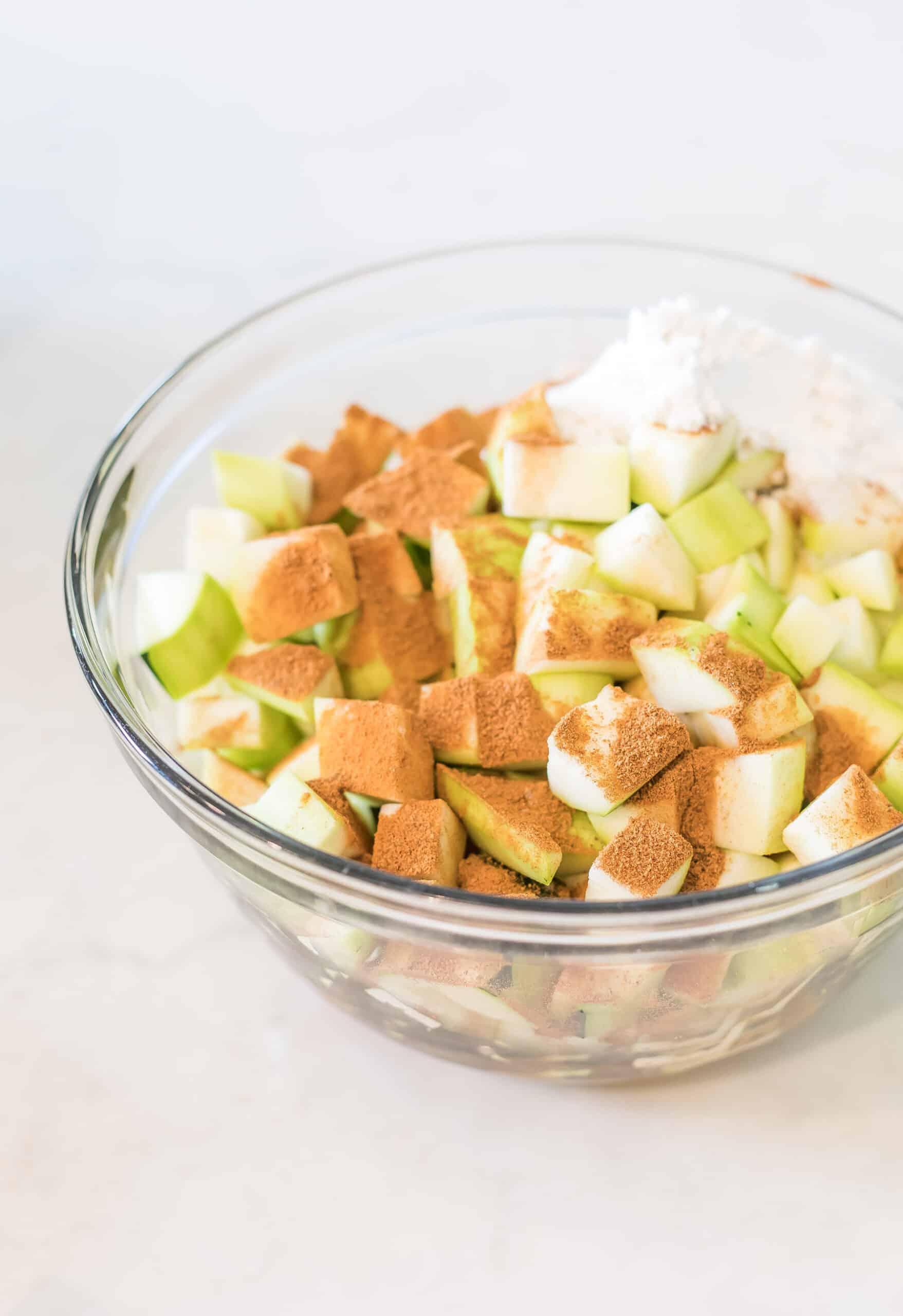 zuchinni in a bowl with apple pie spice