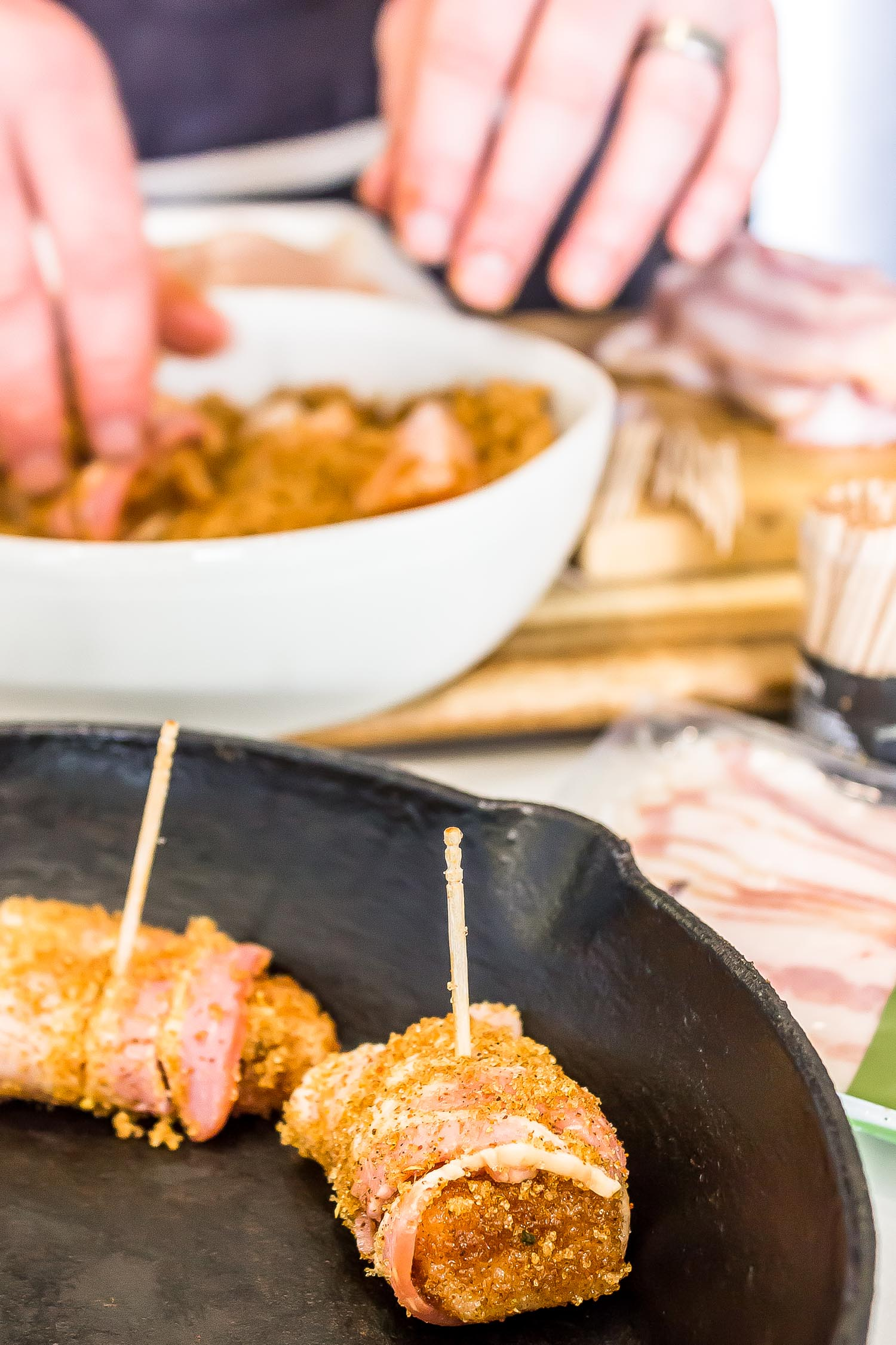 Raw Keto Bacon Brown Sugar Chicken Bites being placed into the skillet