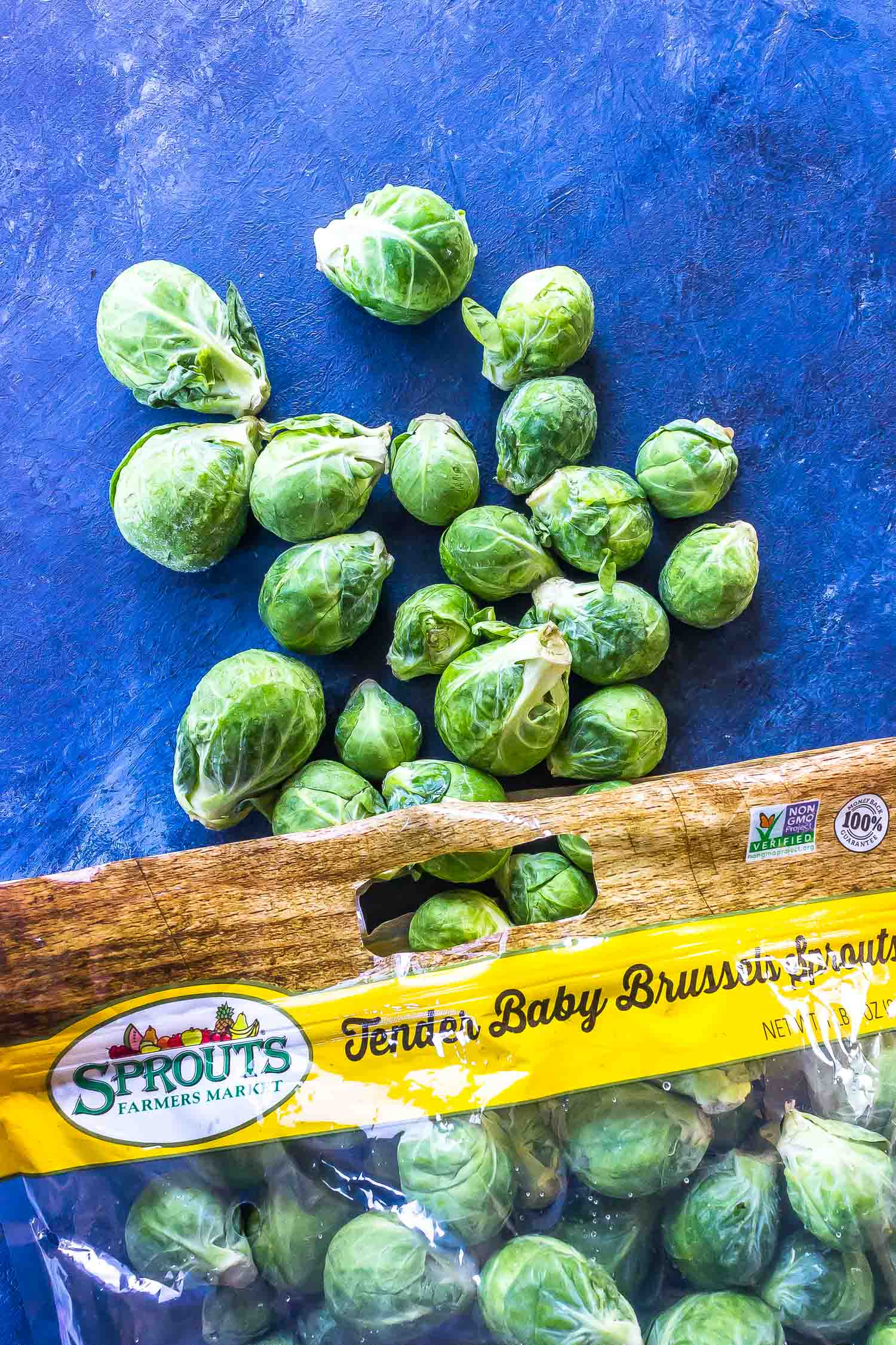 Brussels Sprouts Spilling out of produce bag from Sprouts Farmers market