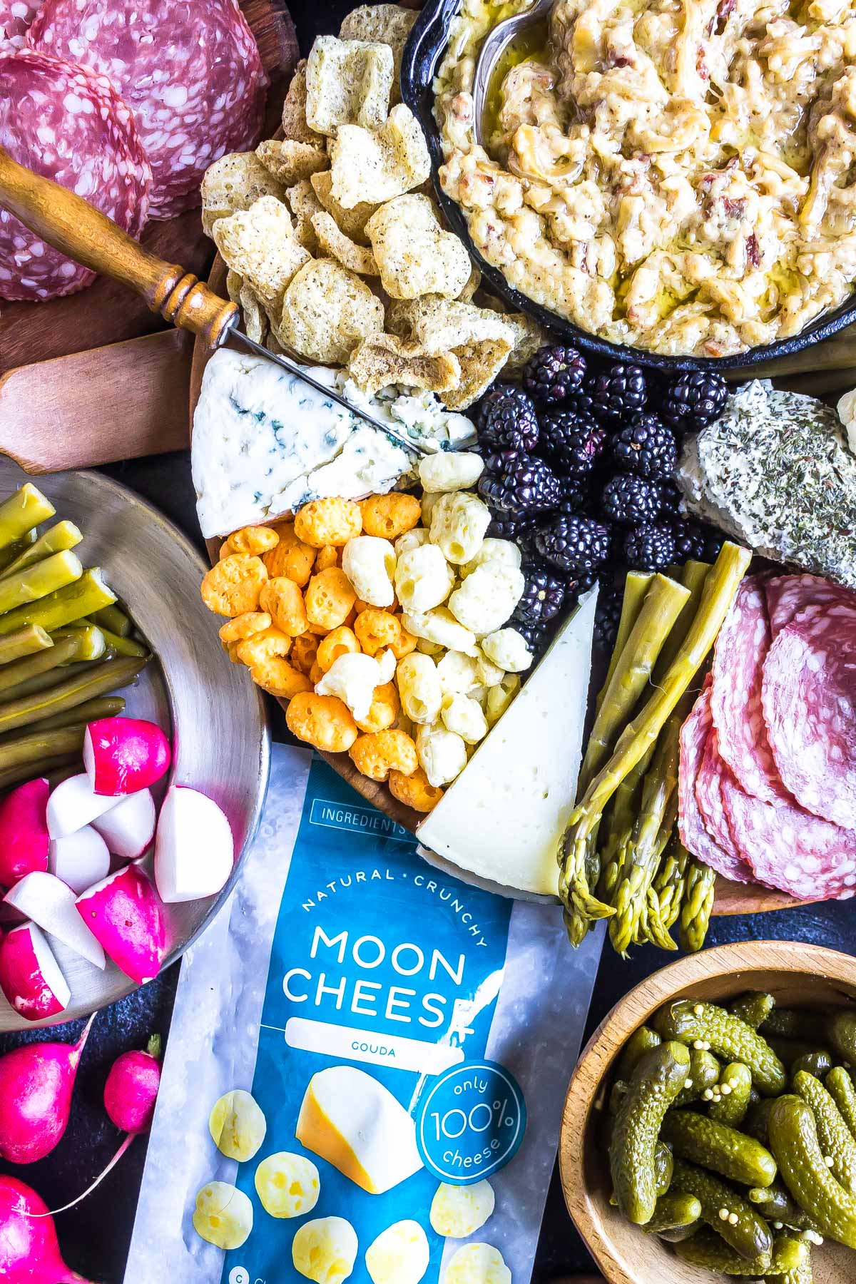 close up image of How To Build a Keto Cheese Board with moon cheese packaging prominently featured