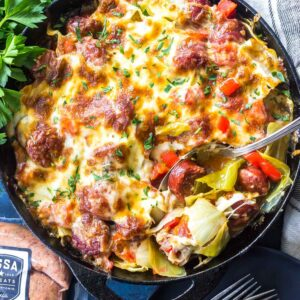 Keto Cheesy Cabbage Sausage Skillet on tabletop