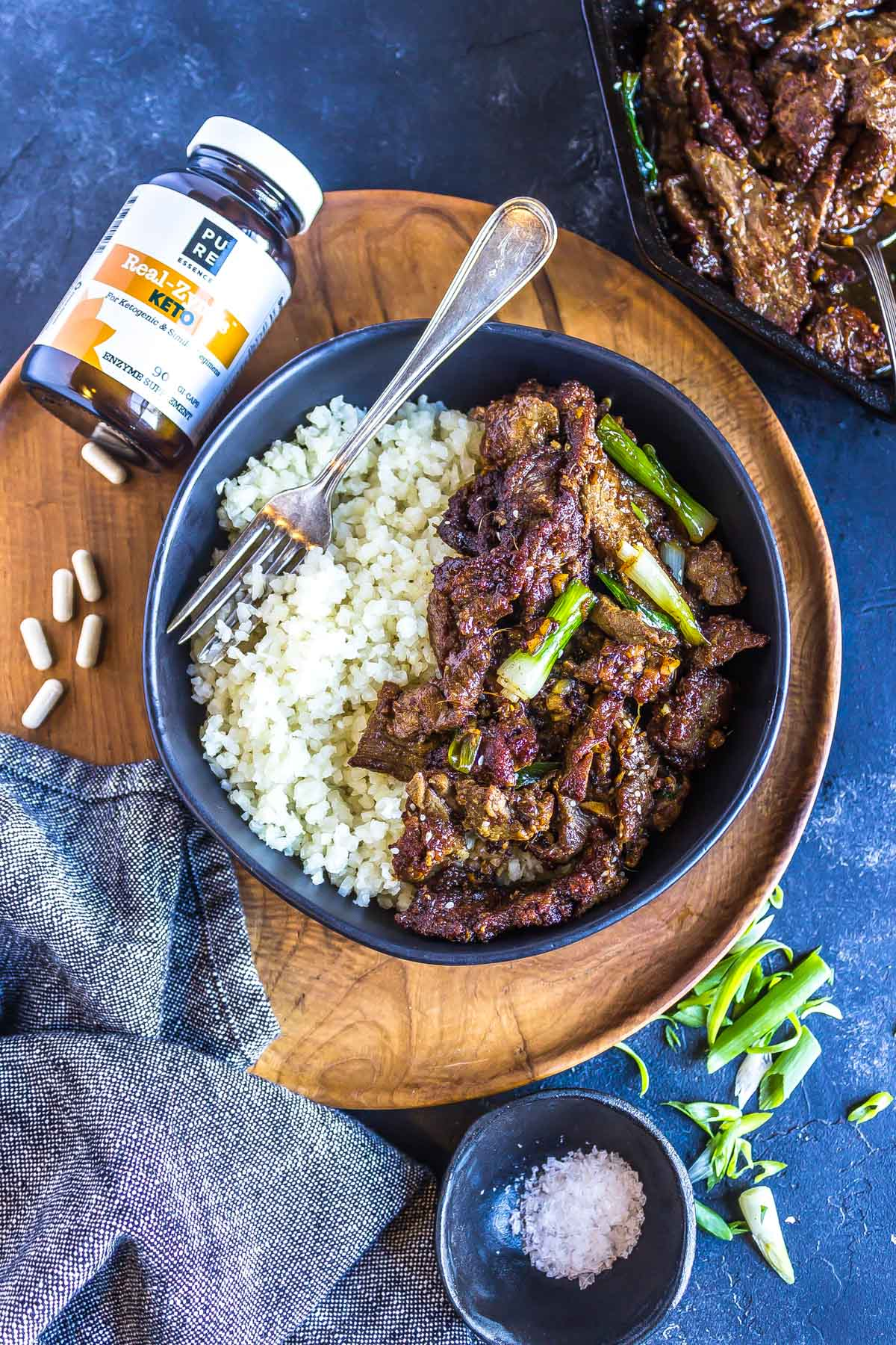 Keto Mongolian Beef with digestive enzymes in the background