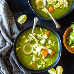 overhead shot of two bowls of keto peruvian chicken soup