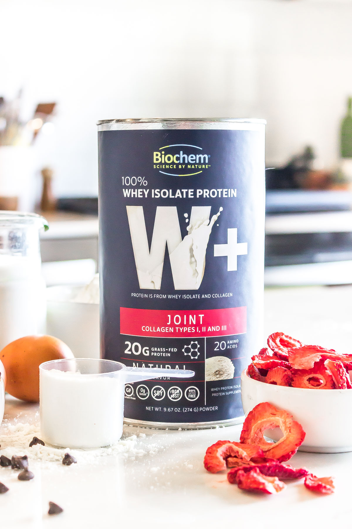 Biochem whey isolate protein plus joint cannister featured with strawberries