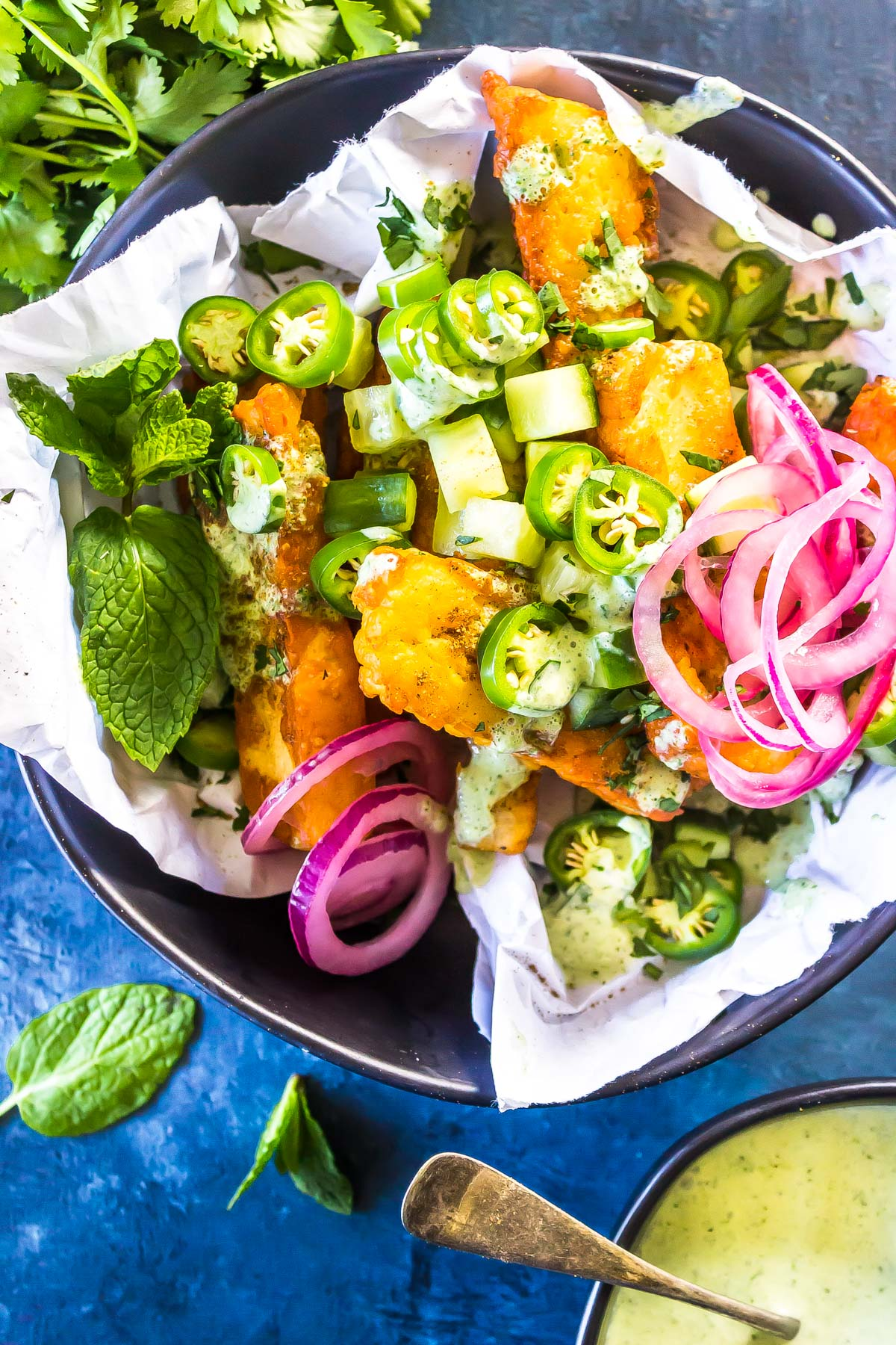 KETO HALLOUMI FRIES in bowl with toppings