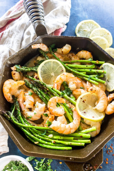 Finished dish: Keto Garlic Butter Shrimp and Asparagus in a cast iron skillet