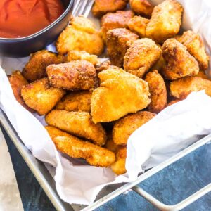 Keto Cheesy Chicken Poppers served with ketchup
