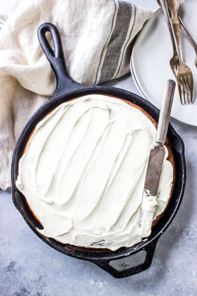 Iced Cinnamon Roll Cake in a Cast Iron Skillet