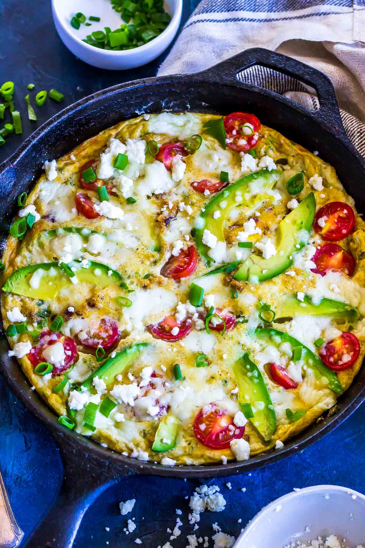 Keto Frittata with Avocado and Queso in a cast iron skillet