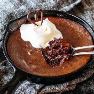 Keto Chocolate Molten Lava Skillet Cake in cast iron skillet