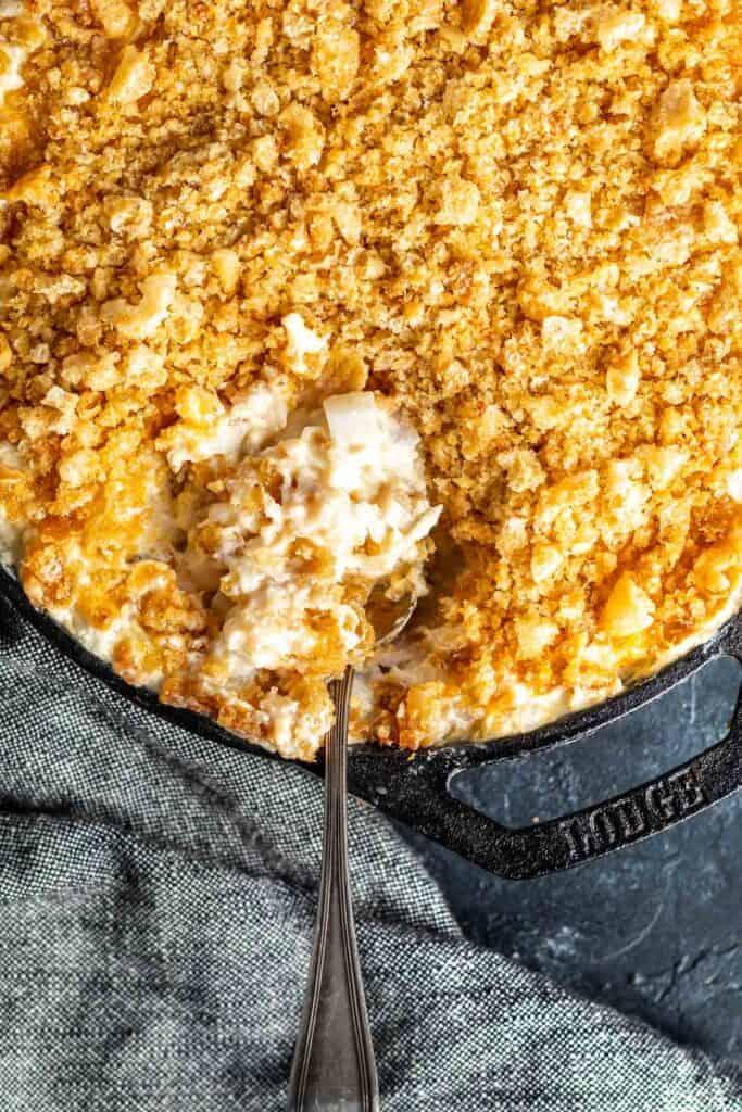 Keto Cheesy Hashbrown Casserole in a cast iron casserole skillet