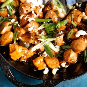 Keto Kung Pao Chicken in a cast iron skillet