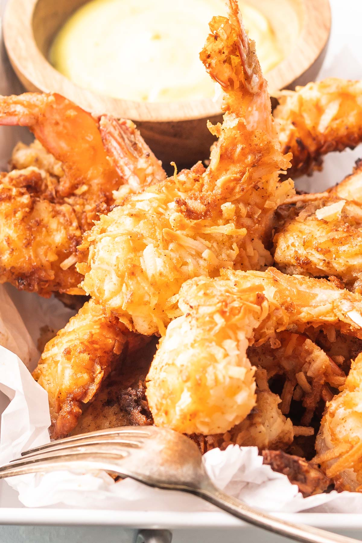 a close-up shot of coconut shrimp in a serving tray