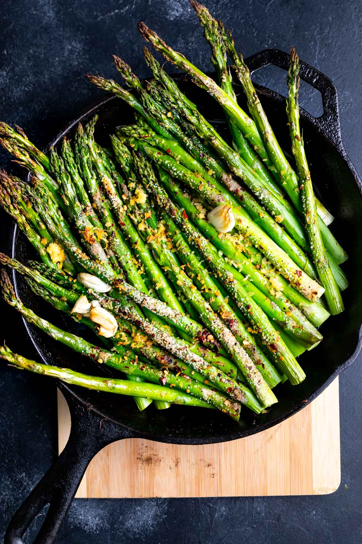 charred asparagus in a cast iron skillet