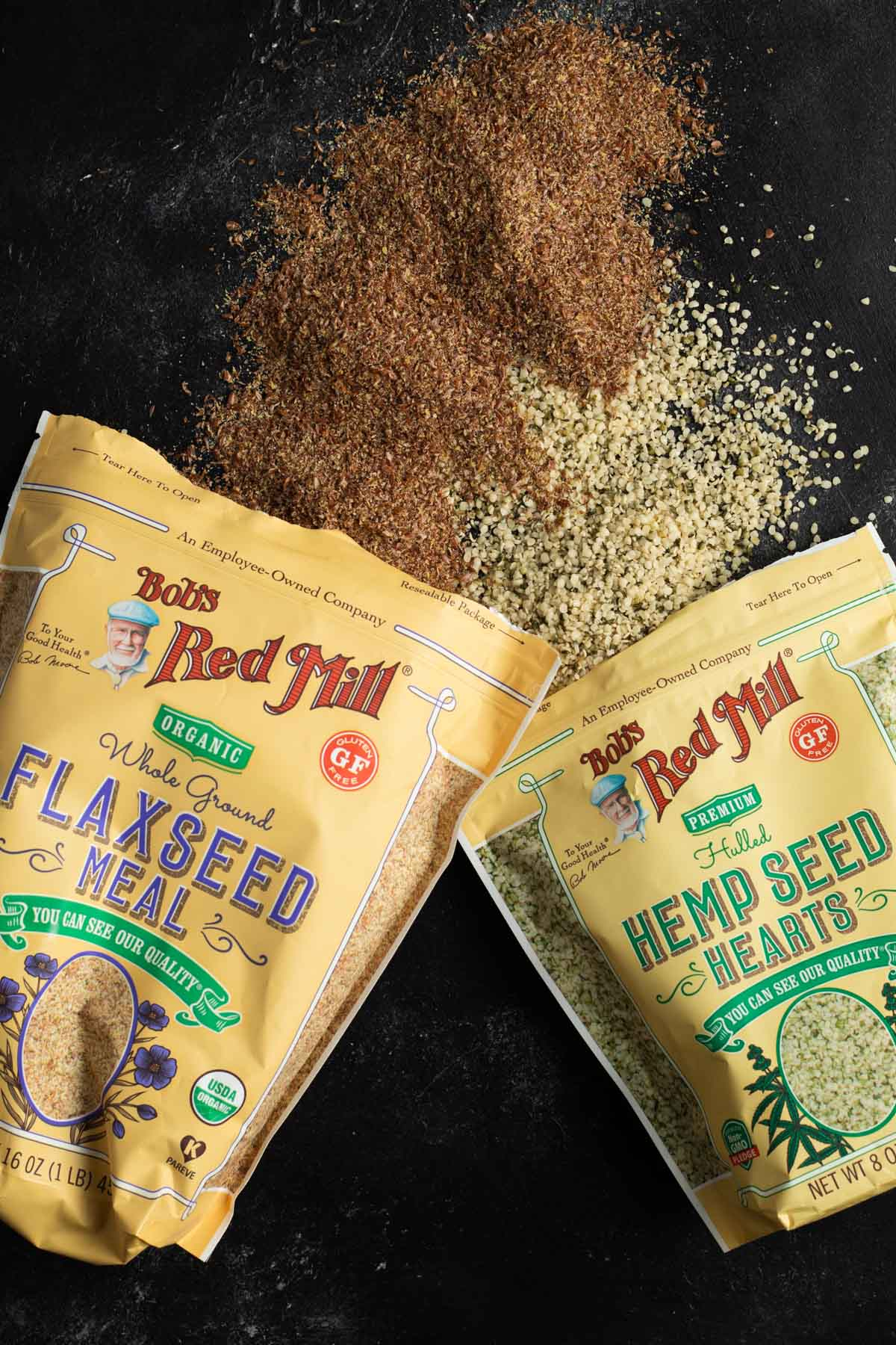 flaxseed and hemp hearts spilled onto a black background
