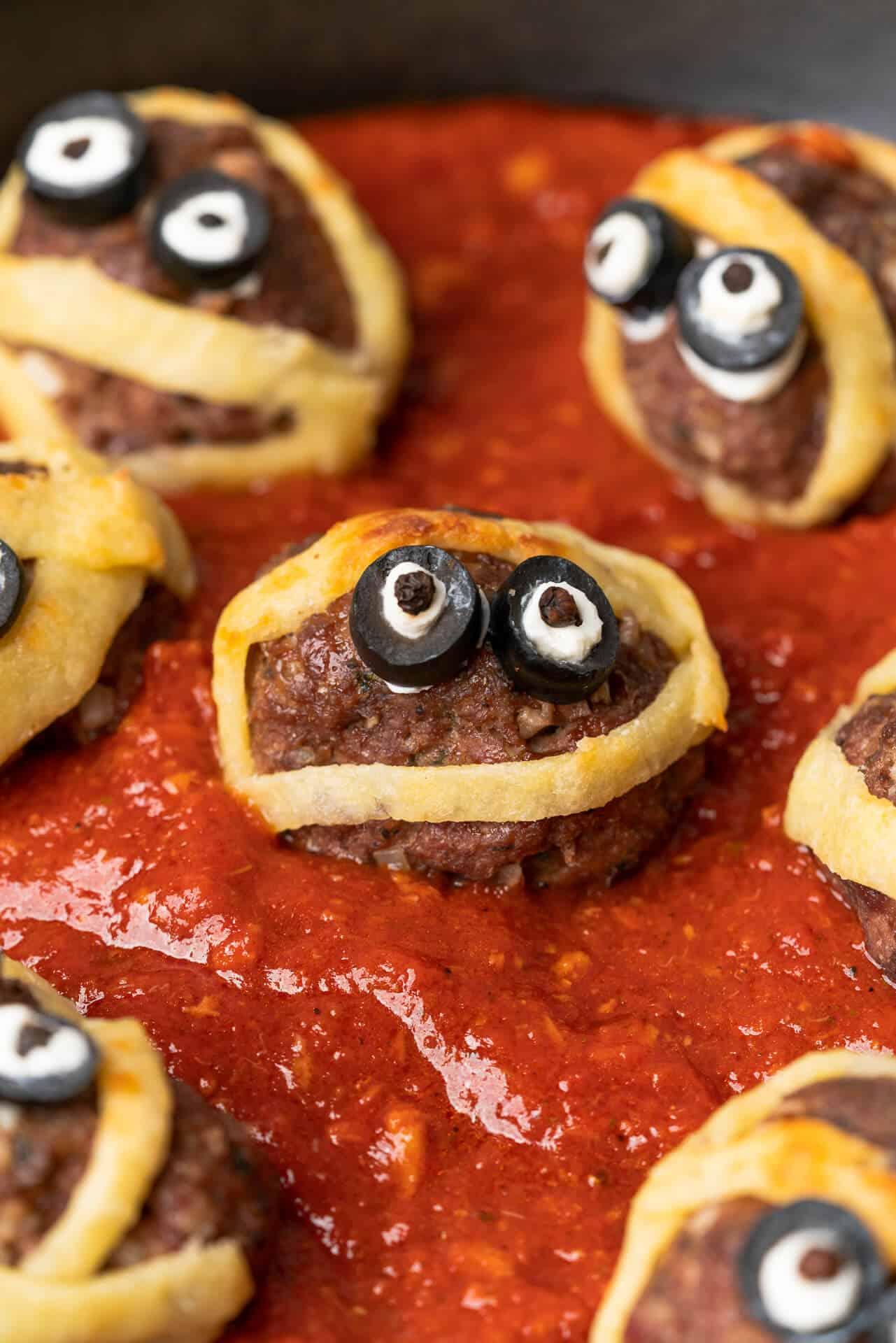 mummy meatballs in a sea of marinara sauce