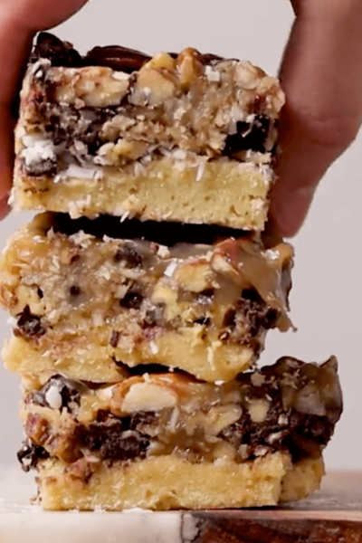 Keto Magic Cookie Bars stacked on top of each other