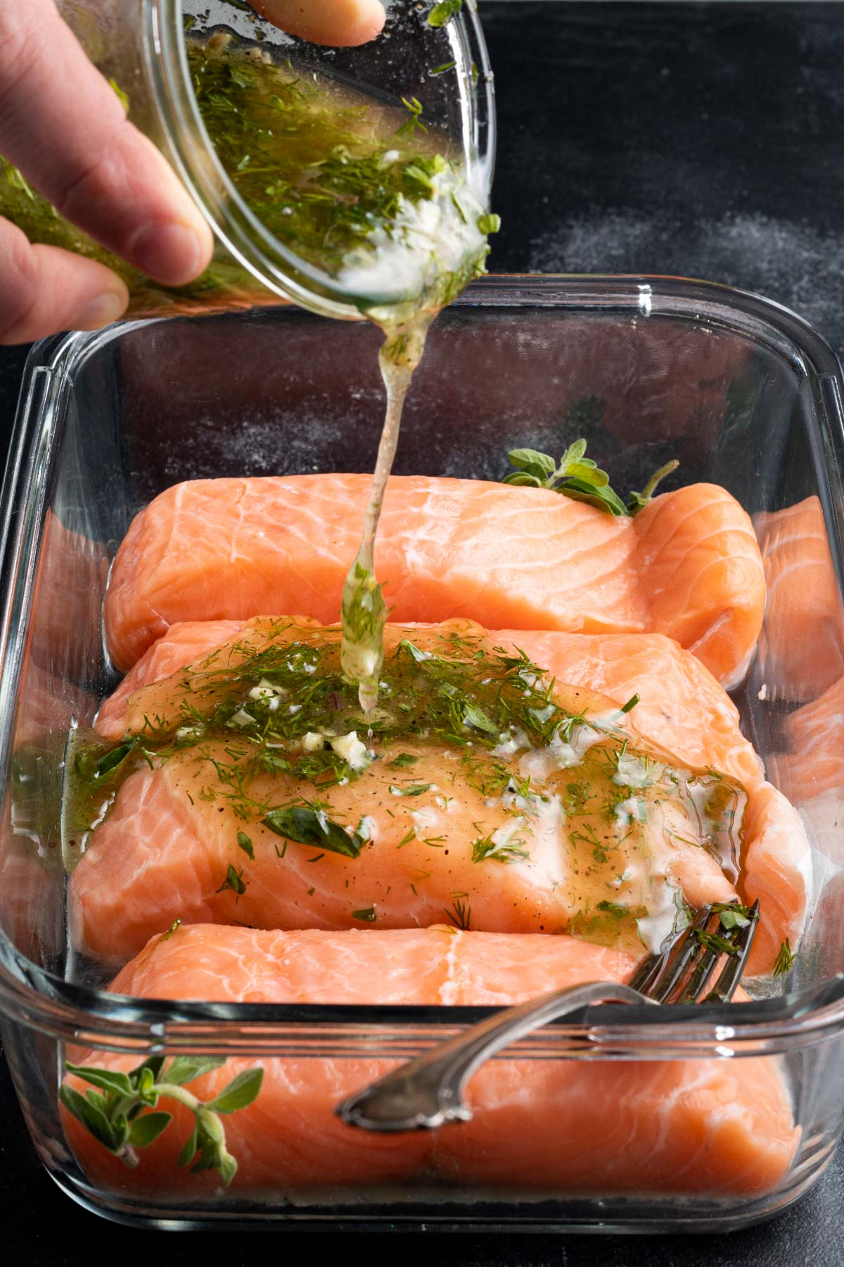 salmon in a glass dish with marinade