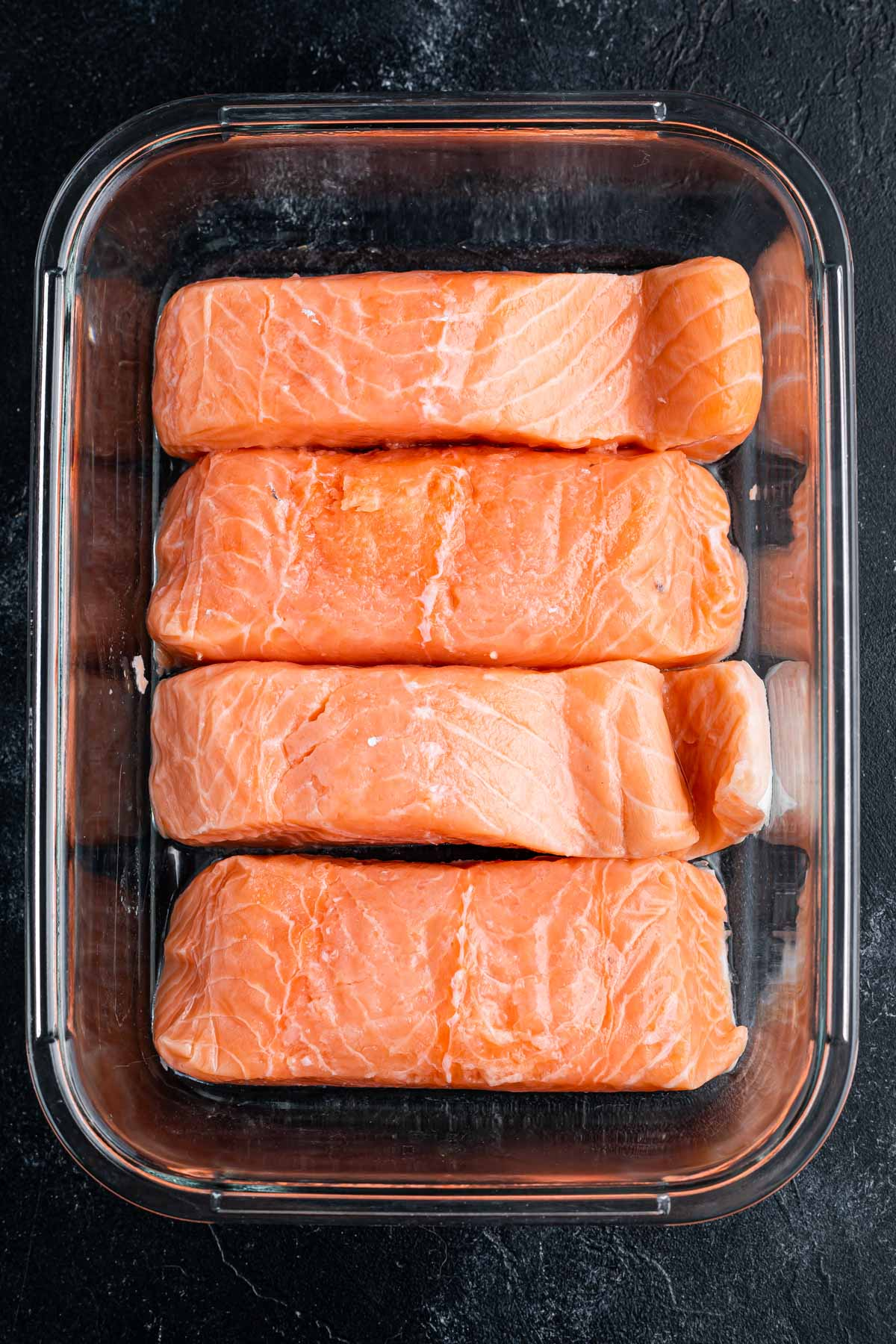 salmon filets in glass dish