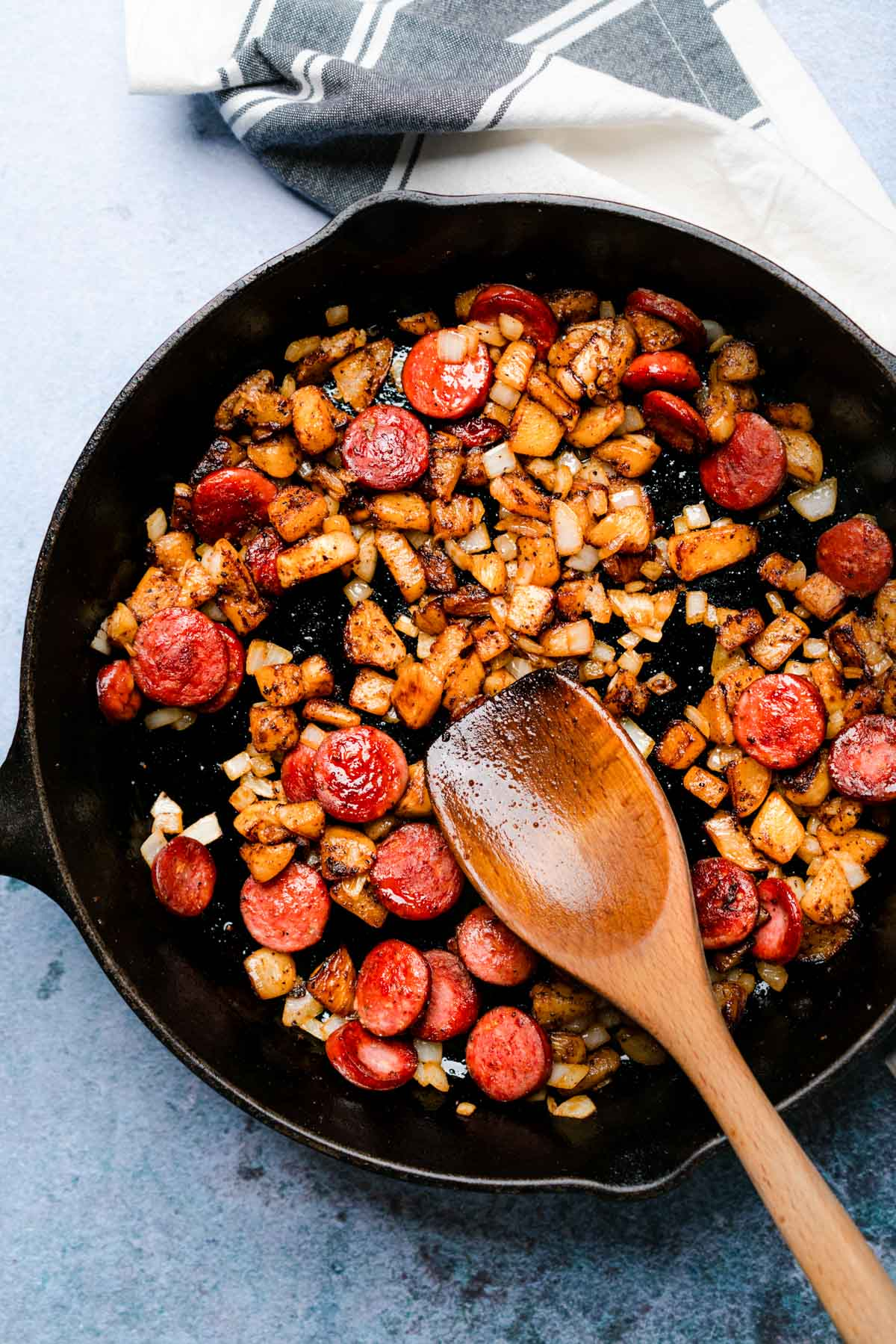 """Cooking the Smoked Sausage Cheesy """"Potatoes"""" in a cast iron skillet"""