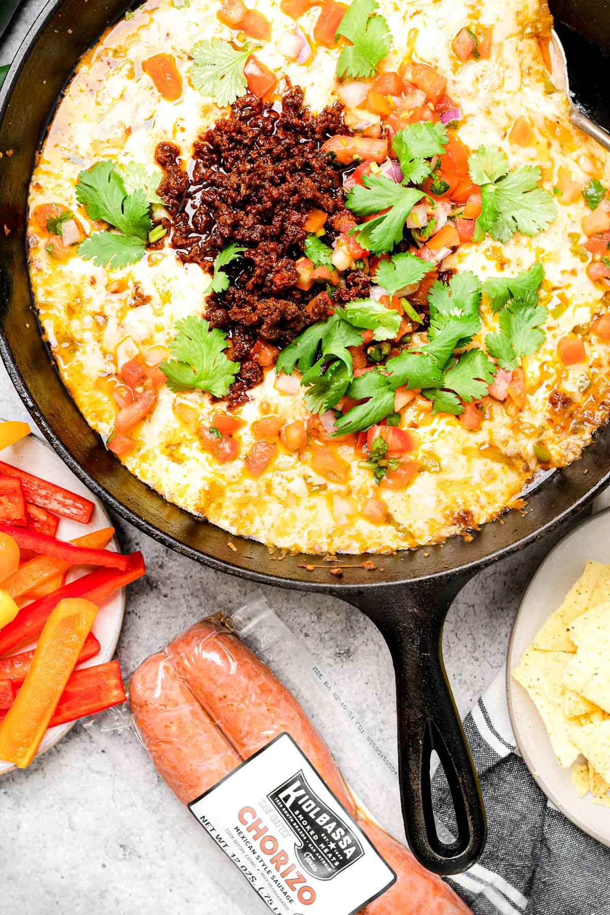 Queso Fundido with Chorizo in a cast iron skillet