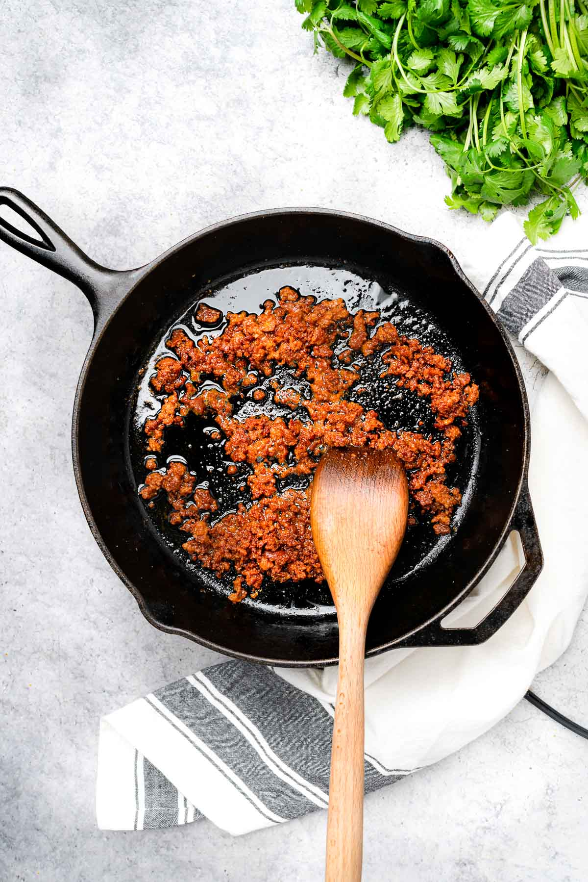 crumbled chorizo in a cast iron skillet
